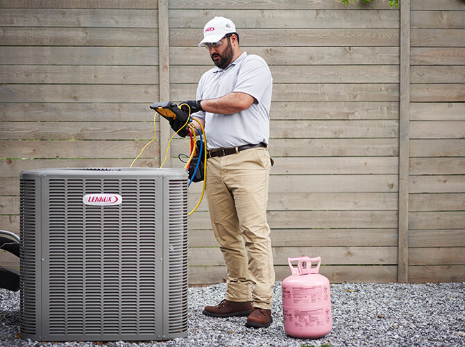 Man working on an air conditioning unit